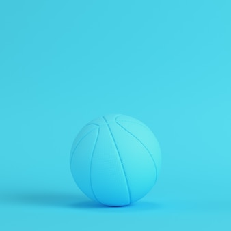 Basketball ball on bright blue background