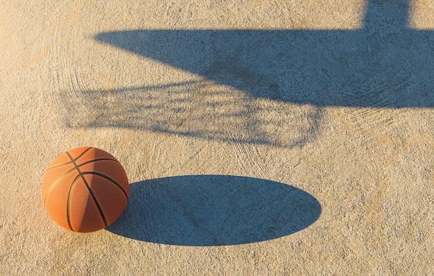 Basketball ball on concrete floor with the shadow of the goal next to it