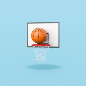 Basketball ball entering in the basket on blue background