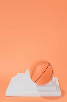 Basketball ball in movement on structures on orange background. sport and competition.copy space. 3d illustration