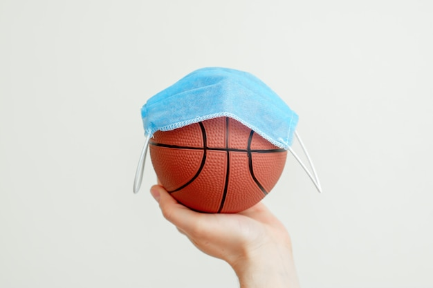 Basketball ball with medical mask