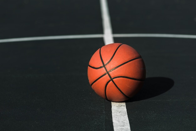 Basketball on court outdoors
