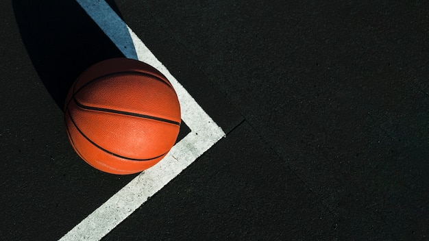 Basketball on court with copy space