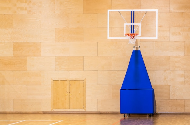 Basketball court with mobile moving basket with copy space
