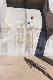 Basketball hitting old concrete wall