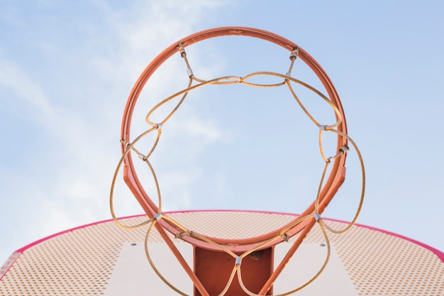 Basketball hoop against blue sky