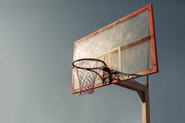 Basketball hoop against the sky. bright sunshine