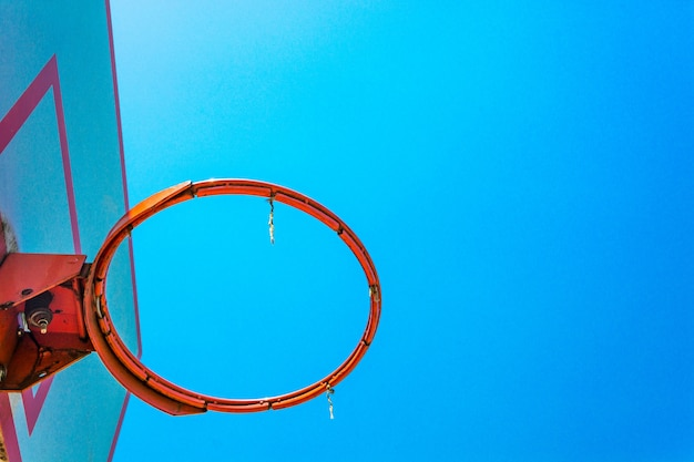 Basketball hoop and backboard with blue sky