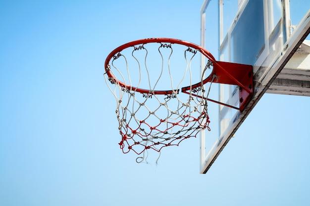 Basketball hoop in the blue sky