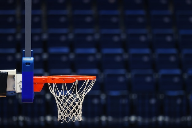 Basketball hoop over the empty seats of the sports arena