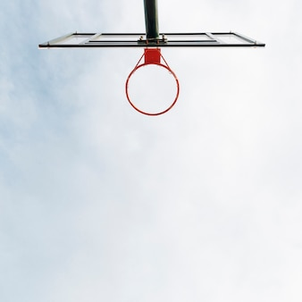 Basketball hoop and net with sky view