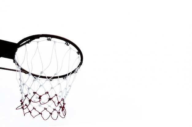 Basketball hoop viewed from below on white background