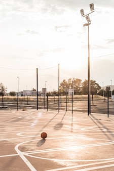 Basketball in court during sunny day