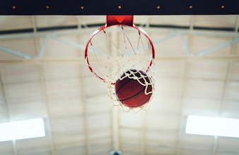 Basketball in hoop net