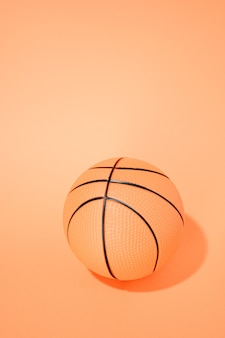 Basketball on orange background. sport and competition.copy space. 3d illustration