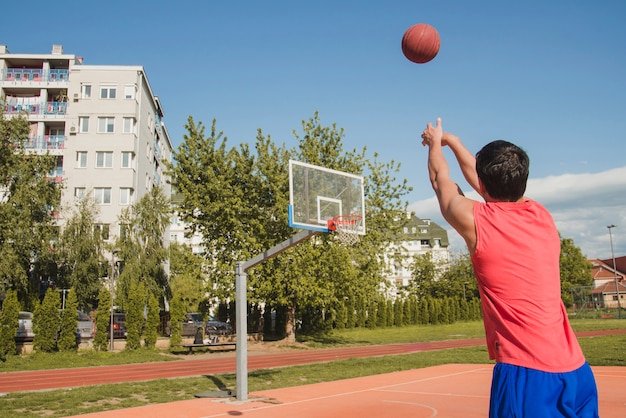 Basketball player attempting distance throw