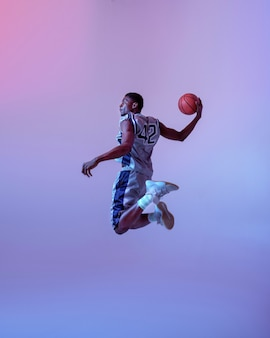 Basketball player jumping with ball. professional male baller in sportswear playing sport game, tall sportsman