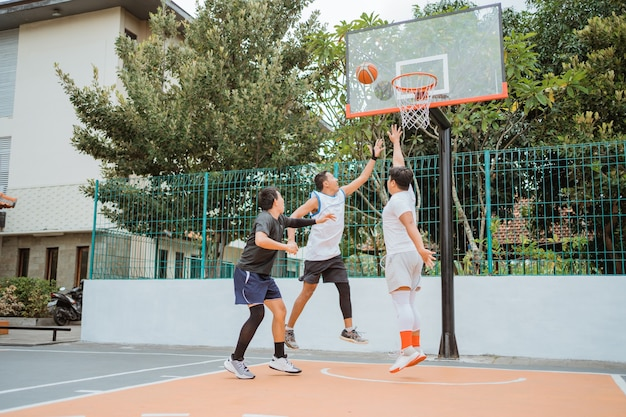 Basketball player jumping with rebound position while playing