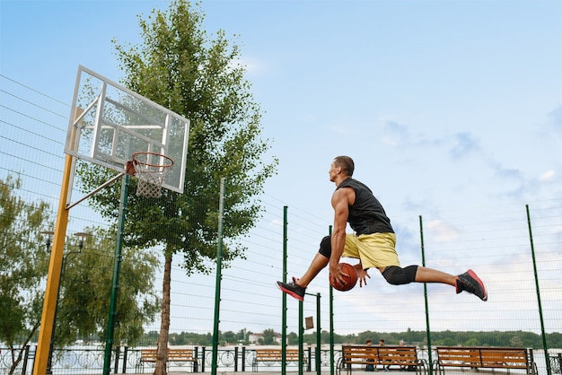 Basketball player makes a throw, shoot in jump