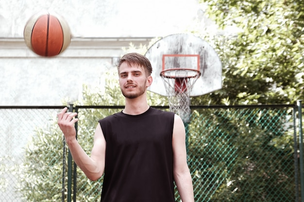 Basketball player practicing and posing with ball