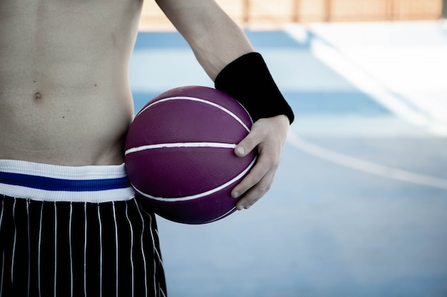 Basketball player with a ball ready to play