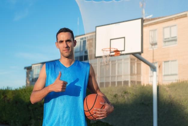 Basketball player with thumb up