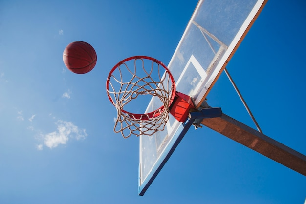 Basketball scene with blue sky