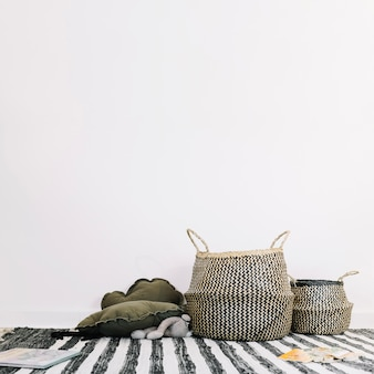 Baskets on striped rag in nursery