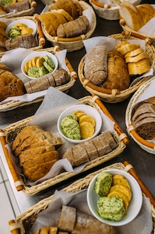 Baskets with baked goods and butter on holiday. catering.