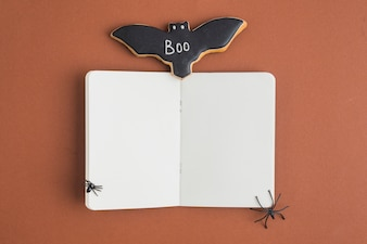 Bat gingerbread near opened notebook