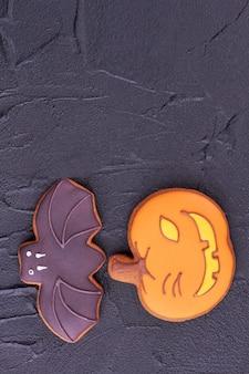 Bat and pumpkin cookies for halloween.