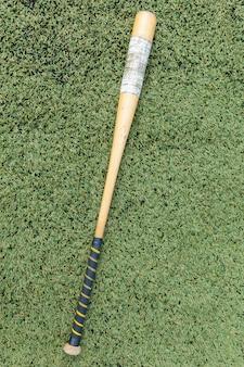 Bat wood for softball on grass field