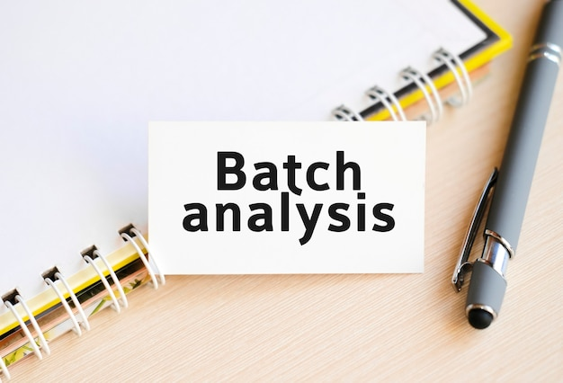 Batch analysis - seo text on a notebook with a spring and a gray handle