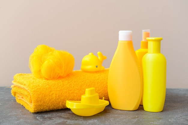 Bath accessories for children on color background