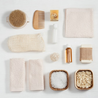Bath accessories from natural material, zero waste set for bathroom, towels, small bottles with gel soap, sea salt, washcloth