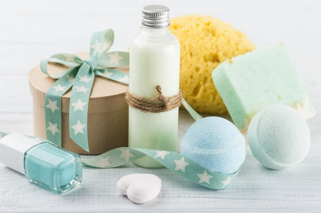 Bath accessories on white wooden table
