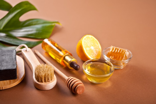 Bath and beauty spa personal hugiene accessories on the brown background