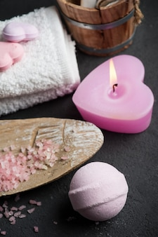 Bath bomb closeup with pink lit candle