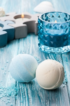 Bath bombs closeup with blue lit candle