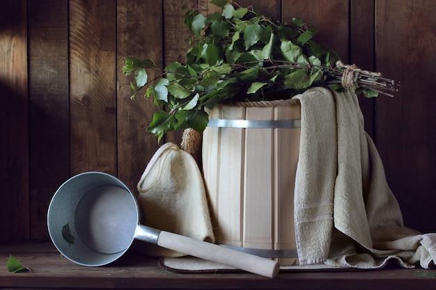 Bath broom made of birch and wooden bucket