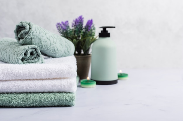 Bath concept with towels and lilac