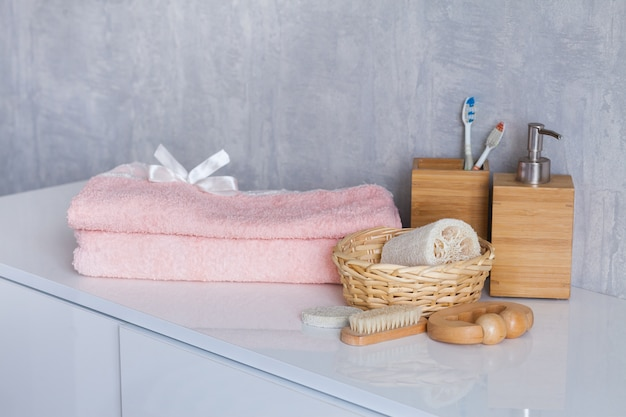 Bath cosmetics and accessories on white table