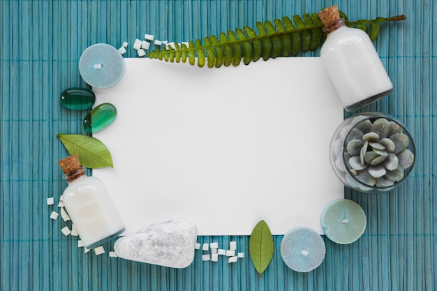 Bath products on blue mat with white rectangle