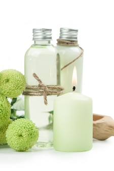 Bath products, candles, wooden background