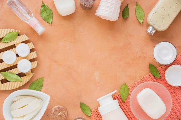 Bath products frame on orange background