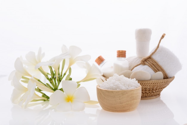 Bath products and skincare treatment with plumeria spa flower on white