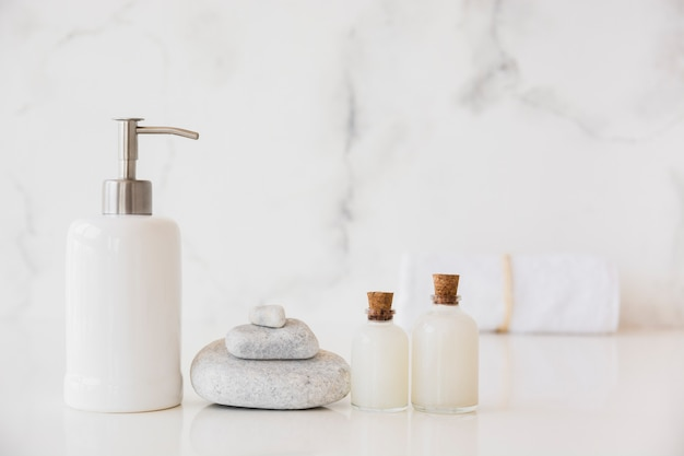 Bath products on table with marble background and copy space