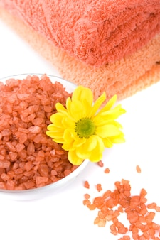 Bath salt, towels and yellow flower