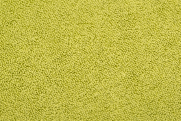 Bath towel bright green. textured fabric background