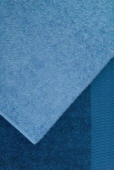 バスタオルを重ねて、青。テクスチャード生地の背景